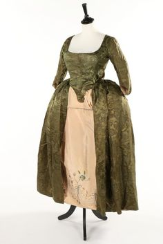Robe à l'Anglaise, late 1770s, and separate petticoat (1780s). Sage-green silk damask satin, woven with large-scale plants; petticoat: cream silk embroidered with floral motifs.