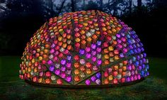 """Glowing pink dome, Beacon on the Hill, is to be constructed from recycled plastic bottles on top of Long Knoll in Wiltshire  http://www.guardian.co.uk/artanddesign/architecture-design-blog/2012/nov/21/breast-bath-beacon-hill-cancer The bottles have been individually sponsored by people whose lives have been affected by breast cancer, each of whom have written a message to be placed inside a bottle, """"helping to illuminate the night with their hopes"""", says Cancerkin."""