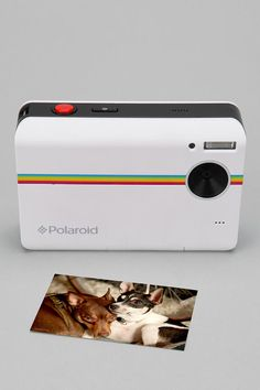 Since I'll be one year older on my birthday/Earth Day, I am going old school with my bday wishes: Polaroid Instant Digital Camera.