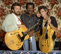 Guitarists Eric Clapton, Chuck Berry and Keith Richards at Chuck Berry's Los Angeles home during the filming of Taylor Hackford's documentary 'Hail! Hail! Rock 'n Roll', 1986.