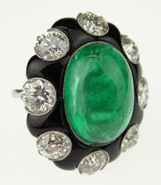 Important Lady's Antique Circa 1900-1910 Gem Quality 17 Carat Colombian Cabochon Cut Emerald, 7 Carat Total Weight Old European Cut Diamond, Platinum and Onyx Ring. Emerald Extremely High Quality