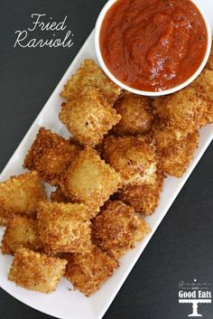 Fried Ravioli with Spicy Marinara - Deliciously easy fried four cheese ravioli. Serve with spicy marinara for the perfect appetizer. Think Food, I Love Food, Good Food, Yummy Food, Awesome Food, Tasty, Clean Eating Snacks, Appetizer Recipes, Meat Appetizers