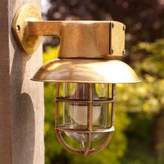 This sweet little brass outdoor light is perfect for lighting