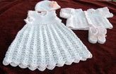 white with pink edging- infants dress with matching hat/sweater/booties