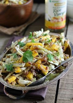 This spicy cilantro mango wild rice salad is filled with cabbage, jicama and pickled jalapenos and tossed in a bright cilantro mango dressing.
