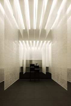 Tokyo designer Gwenael Nicolas of Curiosity has completed a spa in Interlaken, Switzerland, with silk panels hanging in layers from the ceiling. Called Kanebo Sensai Select Spa, the design leads vis. Spa Design, Design Hotel, Deco Design, House Design, Deco Spa, Design Oriental, Fabric Ceiling, Ceiling Panels, Plafond Design