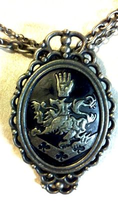 Team Edward? RARE TWILIGHT VAMPIRE FILM NECKLACE EDWARD CULLEN ROSALIE MEDIEVAL LION & HAND HERALDRY PENDANT COAT of ARMS VAMPIRES HORROR FANTASY COSTUMES COSPLAY HALLOWEEN - on eBay! $22.98