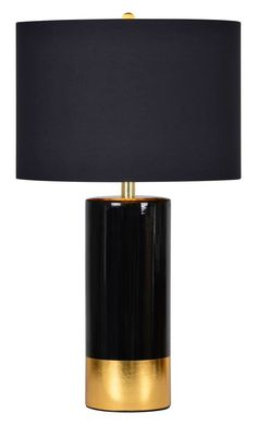 "<p>This table lamp has a crisp black and luscious gold ceramic base as well as a solid black cotton shade with gold interior lining, making it glamorous and alluring. Max Wattage 100 W. Bulb base- E26.Type of Bulb - A. 3-way switch</p> <p>Shade Dimensions: 16""W x 11""H x 16""D</p>"