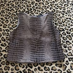 Alice and Olivia giraffe hair top Worn once! No size tag but it will fit a size 2/4 Alice + Olivia Tops Tank Tops