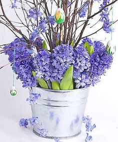 flower arranging Easter twigs and hyacinths