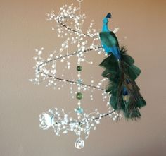 Feathered Dream - Crystal and Pearl Spiral Mobile Chandelier w/ Perched Peacock and Butterfly (Limited Edition Made in Your Choice of Blue/Green Colors or White). $75.00, via Etsy.