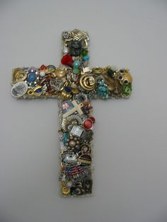 Cross bejeweled 14 inch handcut thick wooden cross. $75.00, via Etsy.