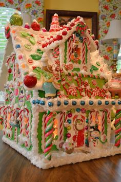 Christmas in the Kitchen Personalized Wood Pre-Lit Gingerbread House by cathypagedaniel, etsy.com. These holiday houses are so gorgeous and colorful, as well as large enough to use as a centerpiece display 2-feet wide by 2-feet long by 2-feet tall!!! I wish I had them all, and though they are not inexpensive, they are worth every penny for the time, patience and intricate details she puts into each one.