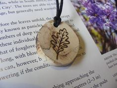 Woodburned spalted oak pendant with oak leaf. Handmade by Woodsmoke Pyrography.