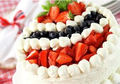 Bløtkake: Norway cake with fresh fruit and cream.