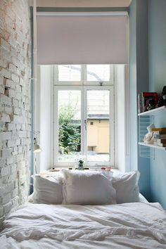 small space bedroom with brick wall