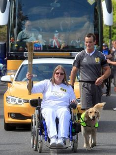 Wendy Morrell was accompanied by her assistance dog, Udo, when she carried the flame in Upton. Wendy overcame disability to become a maths teacher, lecturer, pilot and a national standard archer.