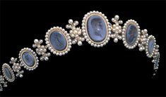 Empress Josephine's Cameo and Pearl tiara. Made of Lapis cameos and pearls set in gold. The center cameo is reputedly a portrait of Napoleon.