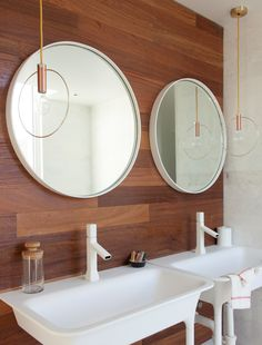 Wood accent wall | Bath with dual vanity with round mirrors