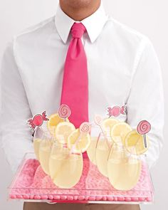 Sweet Drinks Lemon Drop cocktails -- punched up with swizzle sticks -- are served on a tray lined with jelly beans. Party Drinks, Cocktail Drinks, Fun Drinks, Yummy Drinks, Beverages, Cocktail Recipes, Lemon Cocktails, Alcoholic Drinks, Drink Recipes