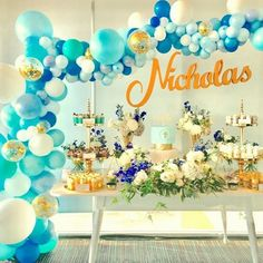 Celebrations add colours to our lives!! Blues and white with a touch of gold! #beautifulballoons to celebrate a special #christening #balloonarch #caketable #quirkyballoons