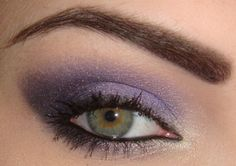 I kinda love purple shadow. and, I love that her eyebrows are angled and balance the eye. always suprised how many people dont know how to use an eyebrow pencil.
