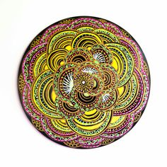 These are so clever and beautiful.  Recycled vinyl records as paintings:  Hand Painted Victrola Record Mandala by FolkHeartRecords on Etsy, $60.00
