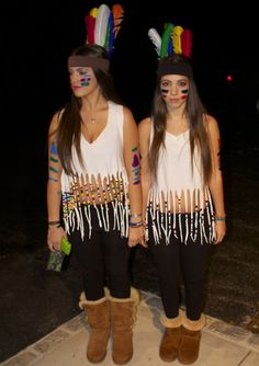 fringe a white tee shirt with beads, black skirt, boots, Wet n Wild blue liquid eyeliner (for tribal marks), free people feather headband
