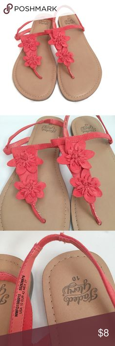 Spring Slip-on sandals Women's Size 10 With flower Faded Glory brand. Spring and summer slip-on sandal. Two little flower accents on the front and a strap around the back. Just slips on the foot. Size women's 10. Perfect bundle item. Faded Glory Shoes Sandals & Flip-Flops