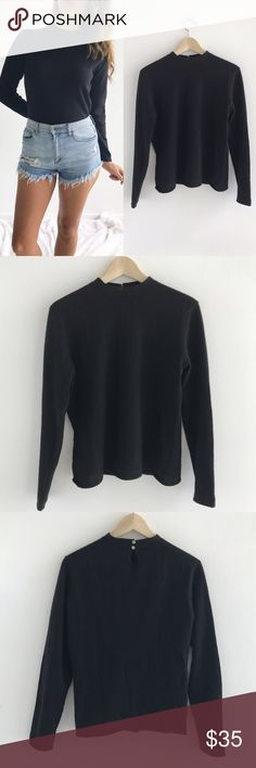 """Ann Taylor Long Sleeve Black Top Ann Taylor Long Sleeve Black Top! Excellent condition. 100% cashmere. Perfect basic piece to have in your closet! Pull over. Buttons behind neck. Measurements- Chest-37"""" length-23.5"""" sleeve-22.5"""" size medium. Ann Taylor Tops"""