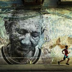 """""""The Wrinkles of the City"""" artwork by JR and Jose Parla in La Havana, Cuba. This is one piece in a series of murals portraying senior citizens who survived the Cuban Revolution (1953-1959)."""