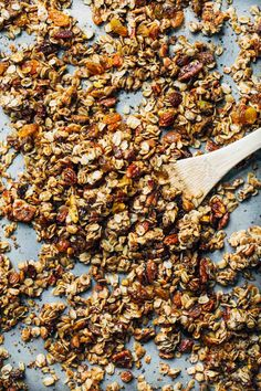 Favorite Coconut Oil Granola - packed with oats, nuts, and dried fruit and NO refined sugar! This is our all time FAVORITE granola recipe!
