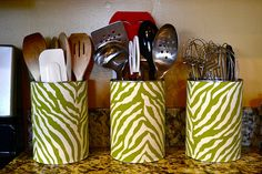 Fabric covered cans used to create cute storage, in the kitchen and beyond.