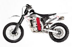 """The Honda CRF450X is a pretty good motorcycle straight out of the box. Every time it's been entered in the Baja races, it's won its class—and Honda has pitched it as """"perhaps the best off-roader ever built."""" But Philadelphia engineer Steve Christini reckons he can go one better. For $6895, he'll sell you a CRF450X…"""