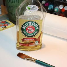 Use Murphy Oil Soap to clean dried paint out of paintbrushes.