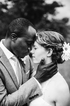 Photo: Abigail Grey maggie walker weddings, black and white photo, braid, floral up do, polka dot tie, bride and groom, daisy, biracial couple, wedding photography, sweet moment, gentle, bride, groom, natural wedding, outdoor wedding