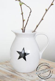 Kan wit met ster zwart