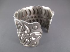 Bold sterling silver cuff bracelet with a strong design & unique style. Great bracelet made by Navajo jewelry artist, Cody Sanderson, with heavy-gauge sterling silver.