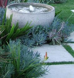 concrete bubbling outdoor fountain -  Elysian Landscapes ; Gardenista