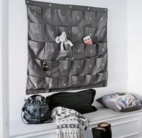 Grey Wally: Organise your life with this wonderful wall storage unit. 30 pockets, each embroided with the alphabet. Available also in white with grey embroidery.  Perfect for the kids room - somewhere to store toys, books, clothes etc.