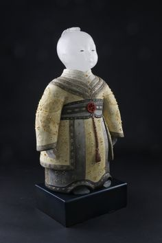 Artist: Vivian Wang  Title: Friendship Boy Process: Cast glass, stoneware, paint, steel base Size: 25 x 13 x 8 Inches Year: 2016 Please contact the gallery for pricing  Habatat Galleries 248.554.0590 – info@habatat.com