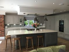 Grey bespoke kitchen, cornforth white and plummet paint, Cox and Cox wooden stools, honey oak van goth flooring. Kitchen Diner Extension, Open Plan Kitchen Diner, Open Plan Kitchen Living Room, Kitchen Family Rooms, Home Decor Kitchen, Kitchen Interior, New Kitchen, Kitchen Grey, Kitchen Modern