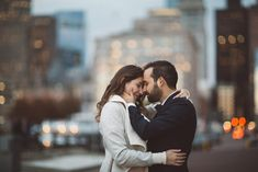 The bride and groom holding one another close at the piers in Boston, Massachusetts | Wedding Photography