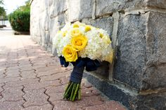 yellow and navy blue bouquet by Sweetest Thing Weddings.