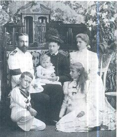 Princess Victoria and Prince Louis Alexander of Battenberg with their children, left to right, Prince George (later 2nd Marquess of Milford Haven), Louis (later Louis Mountbatten, 1st Earl Mountbatten of Burma), Louise (later Queen Louise of Sweden), and  Alice  (later Princess Andrew of Greece and Denmark )