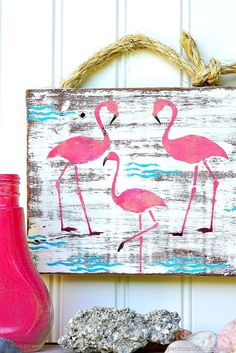 Pink Flamingo wall decor or wall art. The flamingo stencil from FolkArt is the perfect size. I used several shades of pink to give the stencil depth. Pink Flamingos for Summer and Spring decorating.