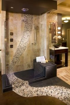 I love how the tile runs out of the shower: Gorgeous Bathroom using a river of…