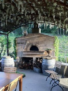 Many beautiful ovens here ... but love this Wisteria hanging down on this one!!