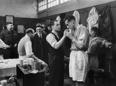 APRIL 1946: AN ARSENAL PLAYER IS GIVEN SMELLING SALTS BY HIS TRAINER IN THE AWAY CHANGING ROOM AT WHITE HART LANE.