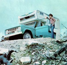 A 60s Ford Bronco with camper in the back